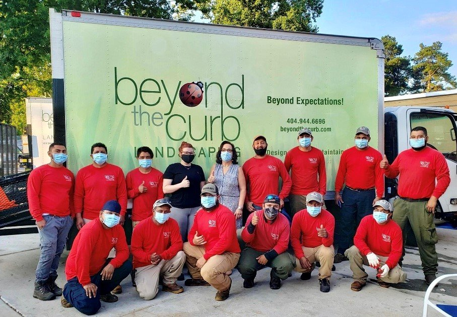 beyond the curb crew with masks